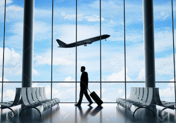23186830-man-in-airport-and-airplane-in-sky