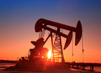 the-sun-setting-behind-an-oil-pump
